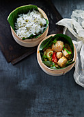 Scallops and rice with banana leaves in bamboo baskets