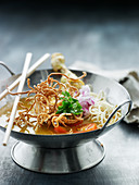 Asian chicken curry with fried noodles