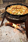 Paella Cooking Outside Over an Open Fire