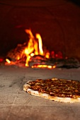 Artisan Pizza Cooking in a Wood Fired Oven