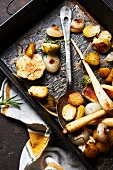 Assorted Vegetables Roasted in Duck Fat with Herbs, Sea Salt and Black Pepper; On Pan with Serving Spoon