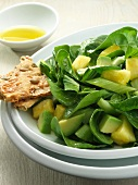 Spinach Salad with Pineapple and Avocado; Bowl of Dressing
