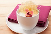 Rice pudding with rose petals and angel's hair pasta