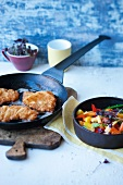 Breaded veal escalopes with stir-fried vegetables
