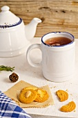 Almond and butter biscuits and ginger tea
