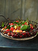 Sweet cherries with leaves in a wire basket