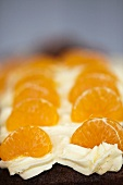 Mandarins and cream cheese on a poppy seed cake