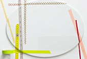 Tape measures and an empty plate