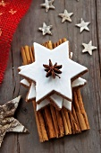 A stack of cinnamon stars with Christmas decorations