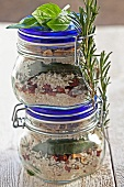 A mixture of dried ingredients for risotto in glasses as a gift