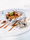 Chicken with vegetables wrapped in aluminium foil