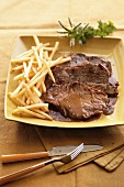 Beef steak with pepper sauce and chips
