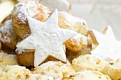 Stollen bites and star-shaped biscuits topped with coconut