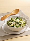 Couscous with green asparagus, courgette, rocket and feta cheese