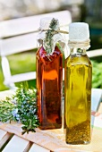 Vinegar and oil in bottles on a table outside