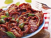 Dried tomatoes with capers and sage