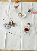 Red wine, salt, pepper and a tip on a table after a meal
