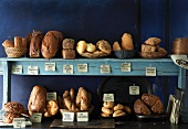 Various bread and bread rolls on a kitchen shelf