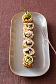 Pancake rolls with surimi and caviar