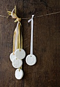 Homemade peppermint creams hanging from strings