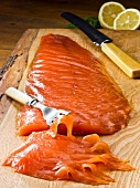 Smoked salmon on a wooden board