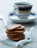 A stack of nut biscuits and a cup of tea
