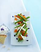 Asparagus with salmon, caviar, edible flowers and quark dip