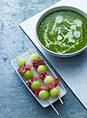 Herb soup and melon and ham kebabs