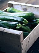 Courgettes in a wooden crate