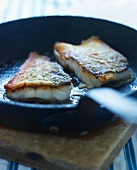 Fried fish fillets in a pan