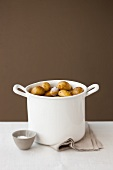 Unpeeled potatoes in a pot of salt water