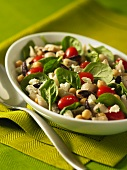 Pasta salad with chickpeas, baby spinach, tomatoes, olive and feta cheese