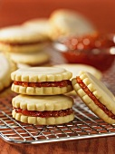 Sandwich biscuits filled with peach and sour cherry jam