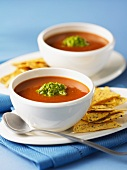 Tomato soup with guacamole and tortilla chips