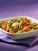 Braised veal ragout with carrots and peas