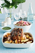 Roast lamb with potatoes, mint sauce and a cabbage salad