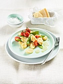 Spelt ricotta gnocchi with tomatoes and mange tout