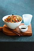 Asian stir-fried noodles with seafood and green asparagus
