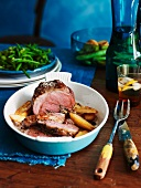 Lamb roulade with baked potatoes