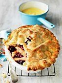 Pear and blackberry pie with vanilla sauce