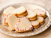 Lemon heart-shaped biscuits with lemon curd and coloured sprinkles