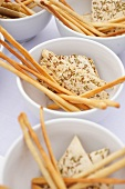 Bowls of Breadsticks and Herb Crackers