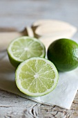 Whole and halved limes