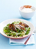 Grilled chicken breast on a bed of salad with bean sprouts
