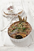 Baked carp with mushrooms for Christmas