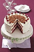 Black Forest Gateaux, sliced, on a cake stand