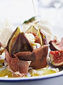 Stuffed figs with yogurt cheese wrapped in ham