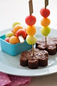 Brownies with melon kebabs