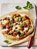 Pizza ai pomodorini (Pizza with cherry tomatoes and basil)