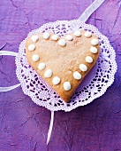 A heart-shaped cake on a doily